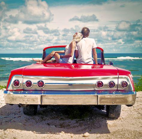istock couple sitting on car