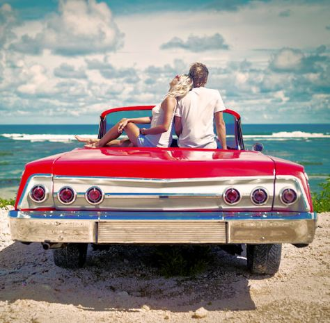 istock couple sitting on car